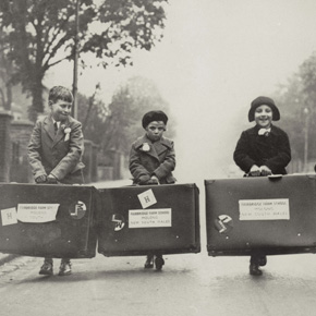 Untitled (Four children with Fairbridge Farm suitcases) *** Local Caption *** Photograph (copied for Child Migration exhibition)  Molong NSW.  Relates Fairbridge Farm School, Molong NSW.  Image depicts four children, two boys and two girls, carrying large suitcases down road. Inscribed on back 'SS ORONSAY 23 April 1938. L to R: Edward (Ted) Gamsley, Mary Simpson, Clara Park, Cyril Lord. Ted Gamsley is still alive and lives in Molong. The other three have passed away'.